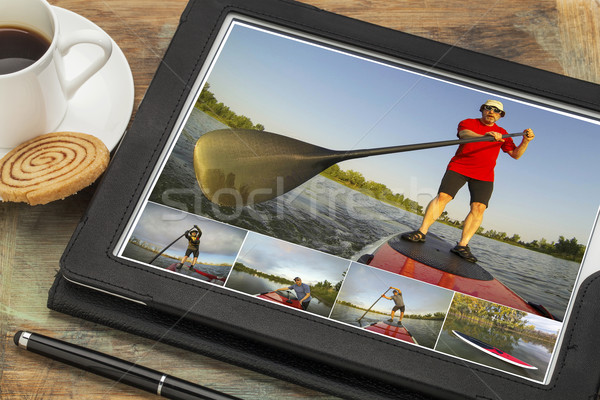 stand up paddling on digital tablet Stock photo © PixelsAway