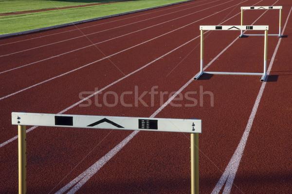 running tracks with three hurdles Stock photo © PixelsAway