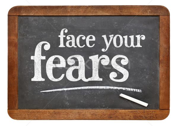 Face your fears advice on blackboard Stock photo © PixelsAway