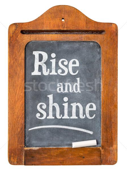 Stock photo: Rise and shine on blackboard