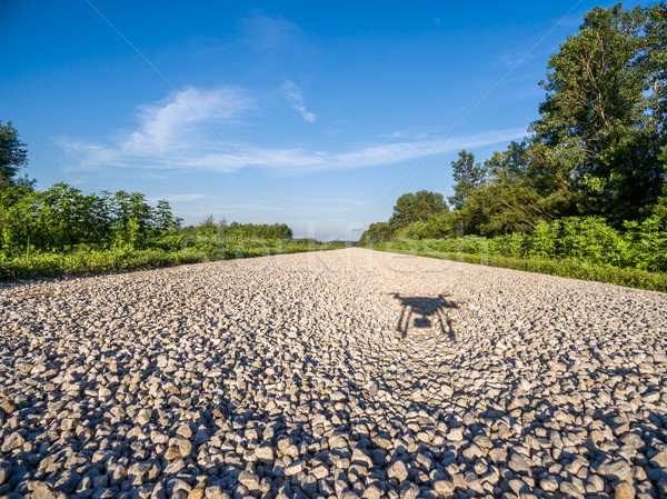shadow of quadcopter drone flying Stock photo © PixelsAway