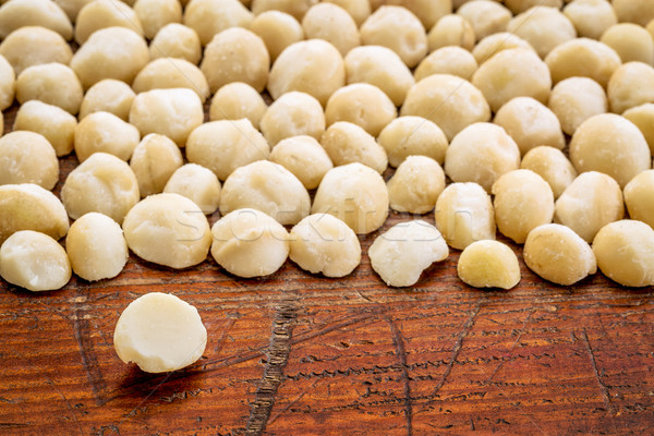 macadamia nuts on rustic wood Stock photo © PixelsAway