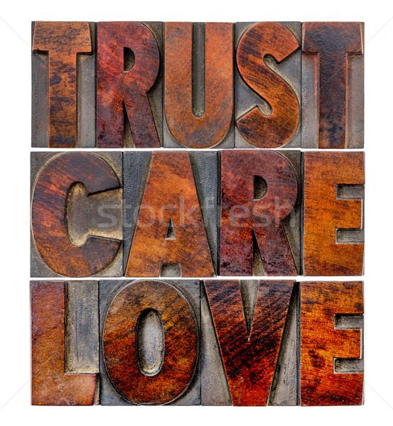 trust, care, love in wood type Stock photo © PixelsAway