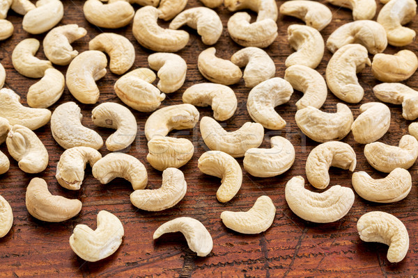 cashew nuts on rustic weathered wood Stock photo © PixelsAway