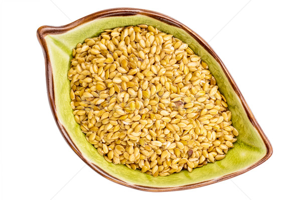 golen flax seeds in a bowl Stock photo © PixelsAway