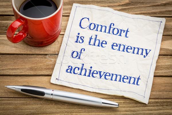 Comfort nemico raggiungimento calligrafia tovagliolo Cup Foto d'archivio © PixelsAway