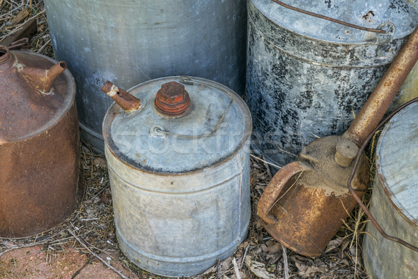 vintage rusty oil cans Stock photo © PixelsAway