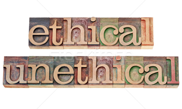 ethical and unethical words in wood type Stock photo © PixelsAway