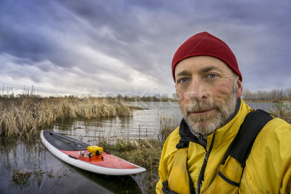 senior SUP paddler self portrait Stock photo © PixelsAway