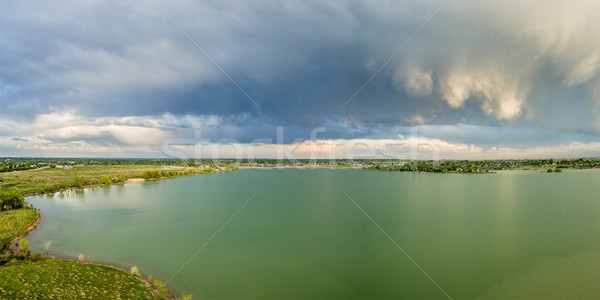 Stock photo: Stormy clouds over lake