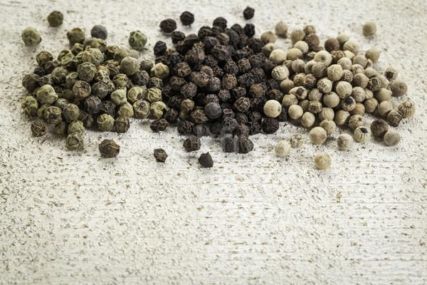 green, black and white peppercorns Stock photo © PixelsAway