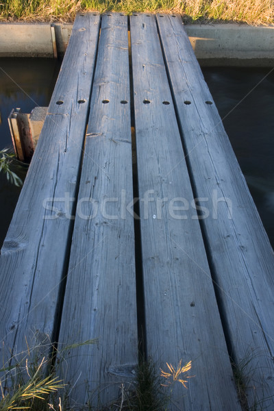 small footbridge over irrigation ditch Stock photo © PixelsAway