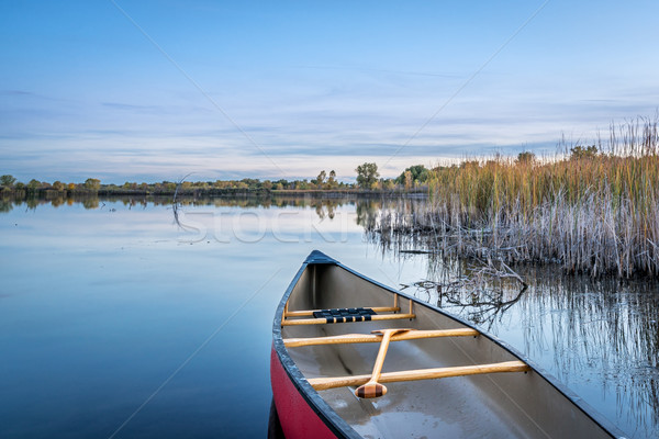 dusk over calm lake with a canoe Stock photo © PixelsAway