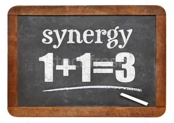 synergy concept on blackboard Stock photo © PixelsAway