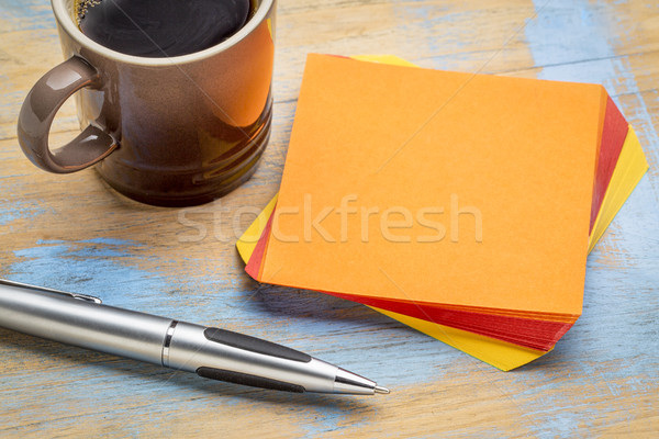 blank orange sticky note with coffee Stock photo © PixelsAway