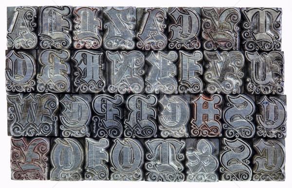 decorative metal letterpress type Stock photo © PixelsAway