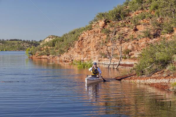 canoe paddler on a mountain lake Stock photo © PixelsAway