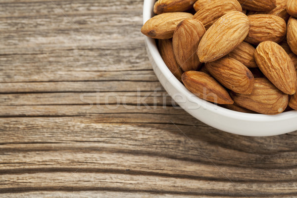 almond nuts in a bowl Stock photo © PixelsAway