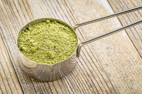 scoop of matcha green tea powder Stock photo © PixelsAway
