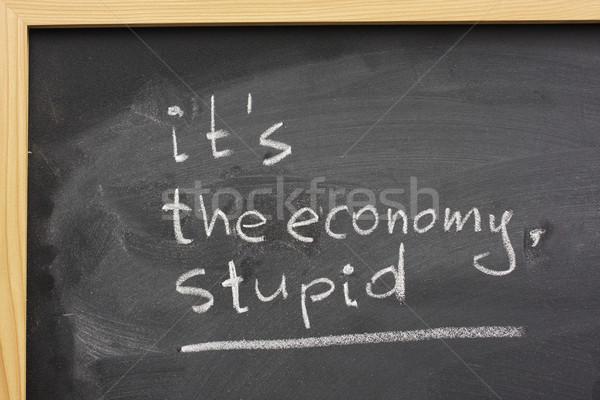 Economia estúpido lousa branco giz Foto stock © PixelsAway