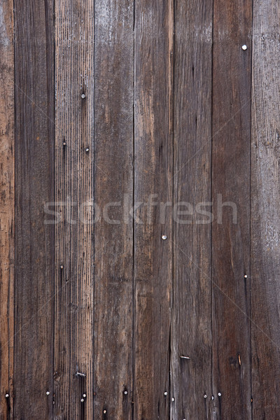 weathered wood with nails and traces of white paint Stock photo © PixelsAway