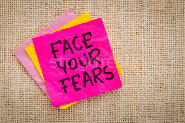 Face your fears advice on sticky note Stock photo © PixelsAway