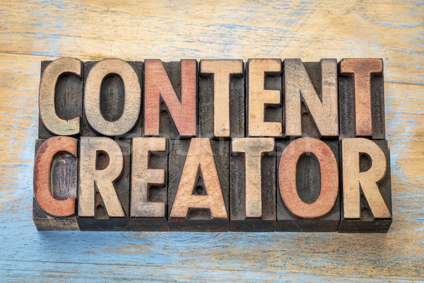 content creator  words in wood type Stock photo © PixelsAway