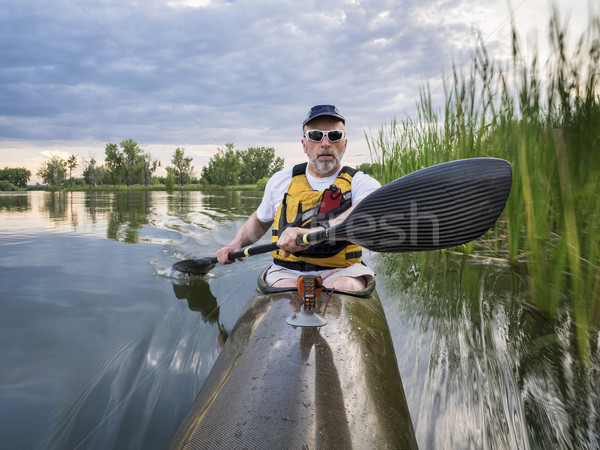 paddling sea kayak on a lake Stock photo © PixelsAway