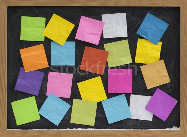 Colorido notas pizarra cubierto notas adhesivas papel Foto stock © PixelsAway