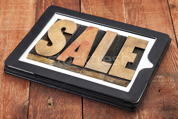 sale word on digital tablet Stock photo © PixelsAway
