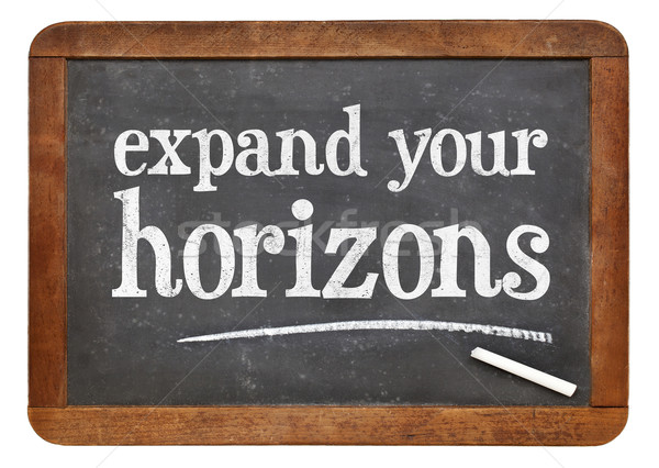 Expand your horizons blackboard sign Stock photo © PixelsAway