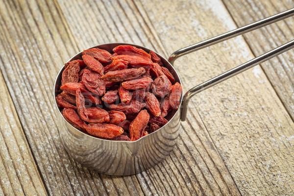 scoop of dried goji berries Stock photo © PixelsAway