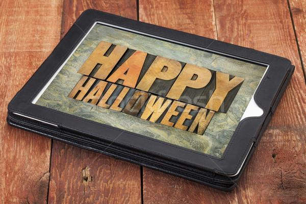Happy Halloween  on a tablet Stock photo © PixelsAway