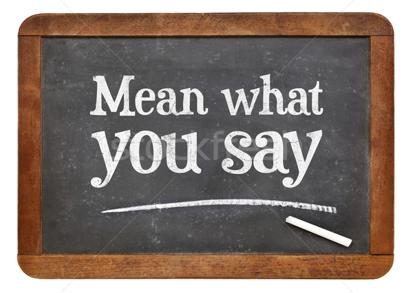 Mean what you say on blackboard Stock photo © PixelsAway