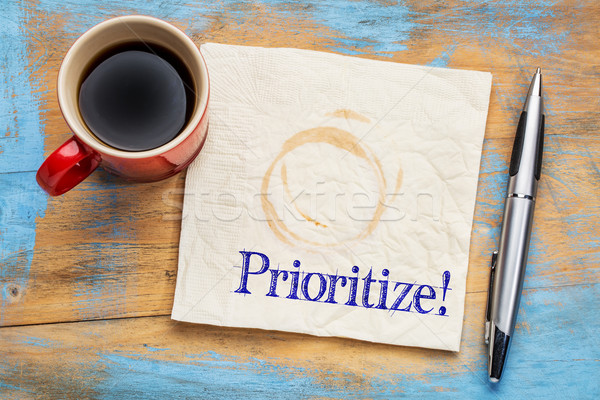 prioritize - reminder on a napkin Stock photo © PixelsAway