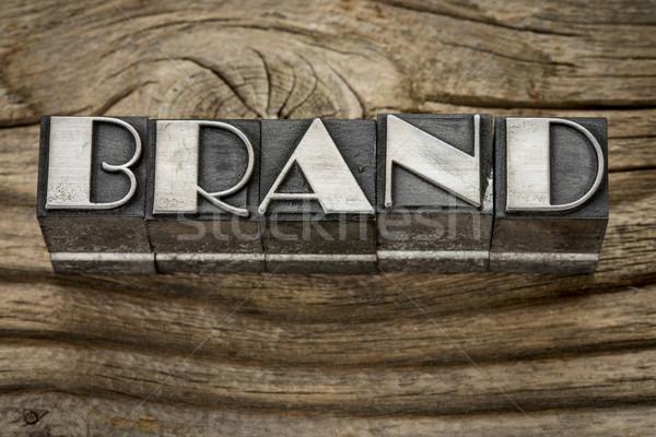 brand word in metal type Stock photo © PixelsAway