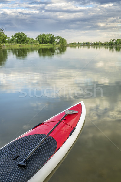 stand up paddleboard on calm lake Stock photo © PixelsAway