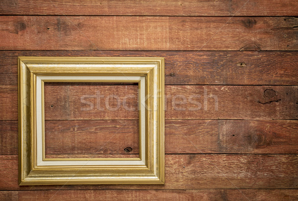 picture frame against rustic wood Stock photo © PixelsAway