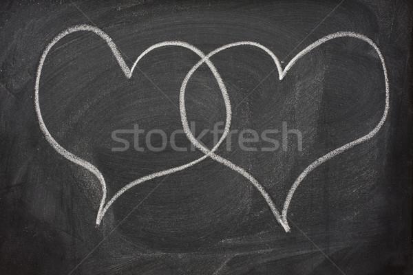 two heart speech bubbles on blackboard Stock photo © PixelsAway