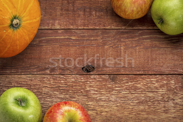 rustic barn wood with pumpkin and apples Stock photo © PixelsAway
