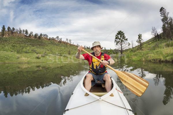 senior athletic canoe paddler  Stock photo © PixelsAway