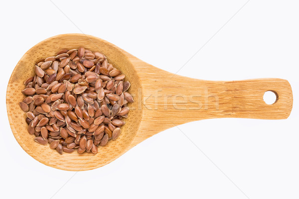 brown flax seeds on wooden spoon Stock photo © PixelsAway
