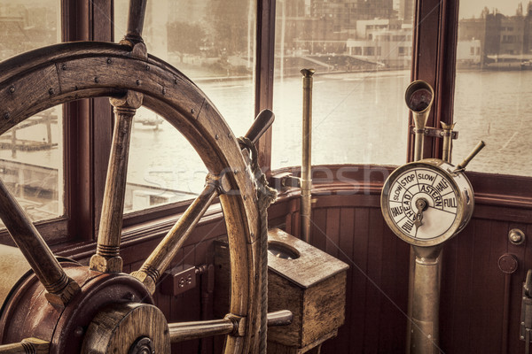 vintage ship steering wheel in sepia toning Stock photo © PixelsAway
