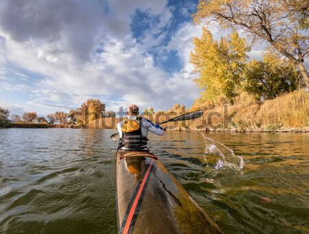 mature male in a canoe Stock photo © PixelsAway
