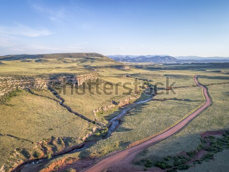 drone flying over mountain valley Stock photo © PixelsAway
