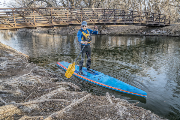 Stand up paddling on the Poudre RIver in Colorado Stock photo © PixelsAway
