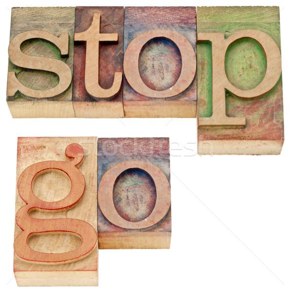 stop and go words in wood type Stock photo © PixelsAway
