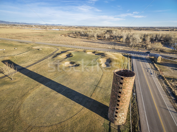 farm silo and golf course Stock photo © PixelsAway