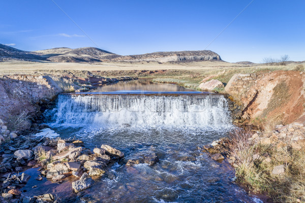 water cascading over a dam aerial view Stock photo © PixelsAway