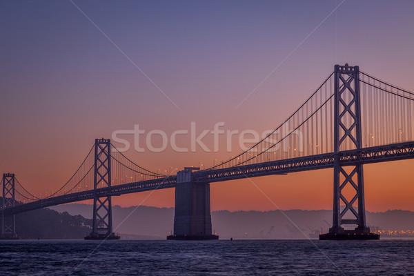 Silueta puente colgante amanecer San Francisco cielo Foto stock © PixelsAway